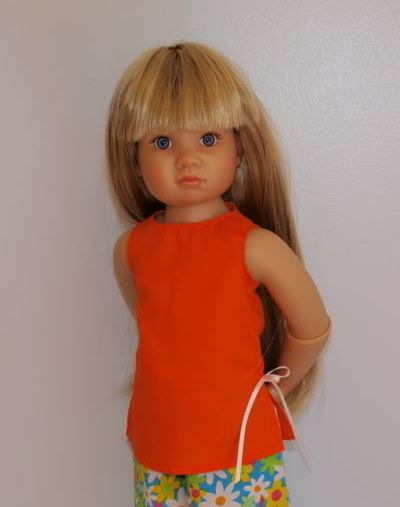 $6 orange cotton top with ties at the side - this is regular fabric not jersey - only 1 left - HTF