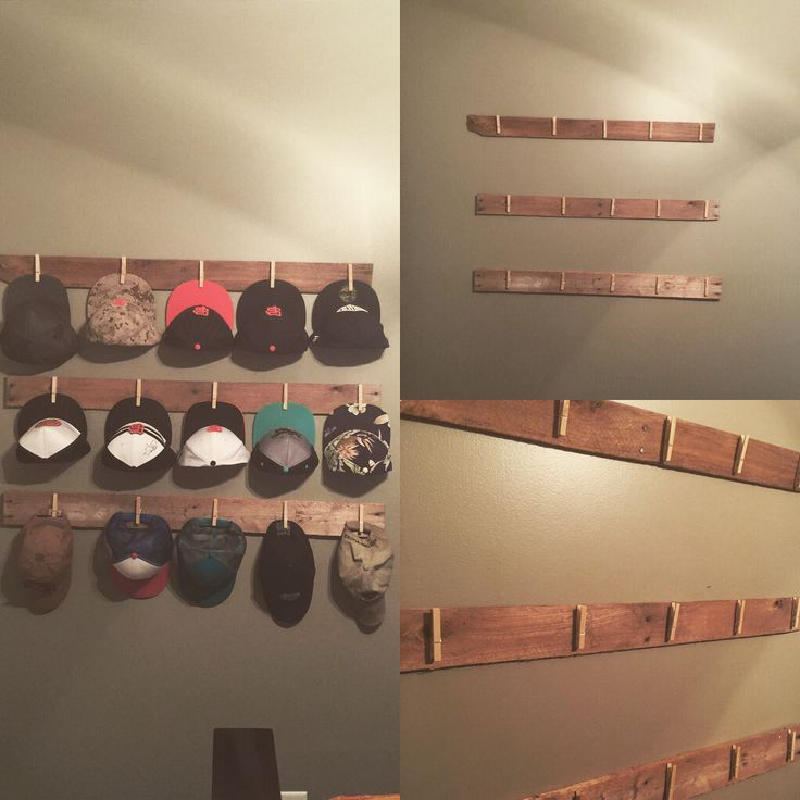 Home made hat rack! Pallet wood with clothes pins hot glued on!
