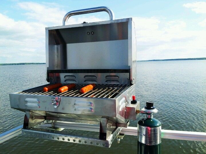 Our pontoon grill.. We got the portable grill from lowes. Then made a frame and mounted it the boat. Turned out amazing!