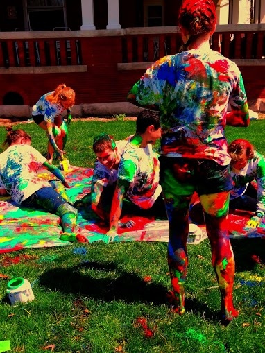 Paint Twister... College just got a little better! We used acrylic house paint, but next time, I highly recommend using washable kid paint (so much less of a pain to wash off). For every 10 people, one pint per color should be fine to cover two games. Also, we used plastic paint tarps although a lot still got on the grass. In any case, this made for such a great RA program and just a fun time in general!