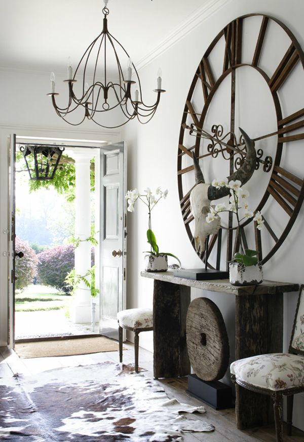 Rural chic, beautiful rustic furniture teamed with raw hide rugs and iron work.. Gorgeous
