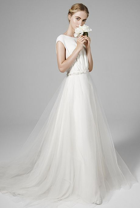 Brides: Peter Langner. Crepe cady sheath dress. Detachable overskirt in tulle with beaded belt.