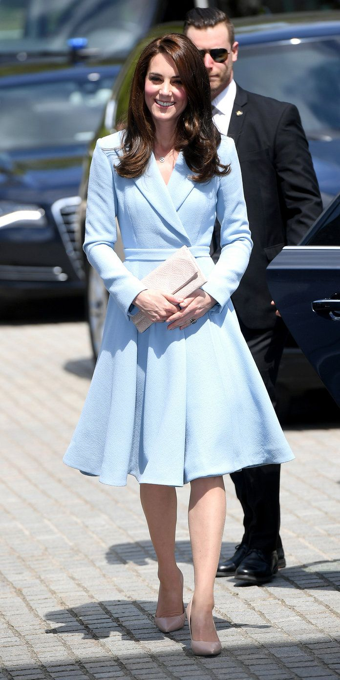 Middleton looked like a real-life princess on a royal visit to Luxembourg on Thursday in ababy blue coatdress by Emilia Wickstead that cinched at her waist and finished with an A-line skirt.She paired the coat with a nude clutch and matching pointed-toe pumps (shop a similar stylehere), accessorizing with drop earrings and her stunning engagement ring. from InStyle.com