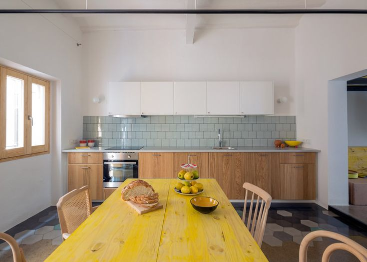 Nook Architects completes renovation in Barcelona apartment building.