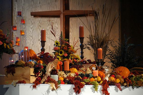 Thanksgiving decorations adorn the altar during the for Altar decoration ideas