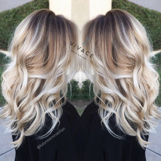 Blonde Balayage Highlights with Curly Long Hair by rena