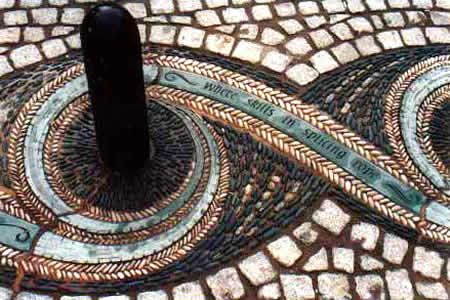 Maggie Howarth's pebble mosaic integrated with the bollards at Whitehaven Marketplace