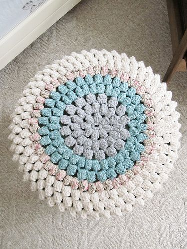 Love this footstool cover...this blog is kind of strange...the cadence of the writing is off the wall.