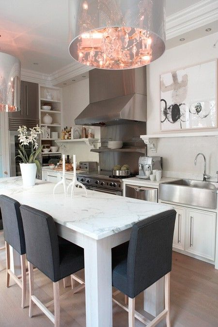 Marble topped eating island via Lynda Reeves' Kitchen Renovation | House & Home