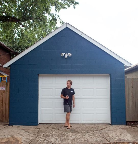 It may not be the hang-out spot, but why shouldn't your garage look as nice as your house? With just a little bit of color, this garage goes from gray to gorgeous.