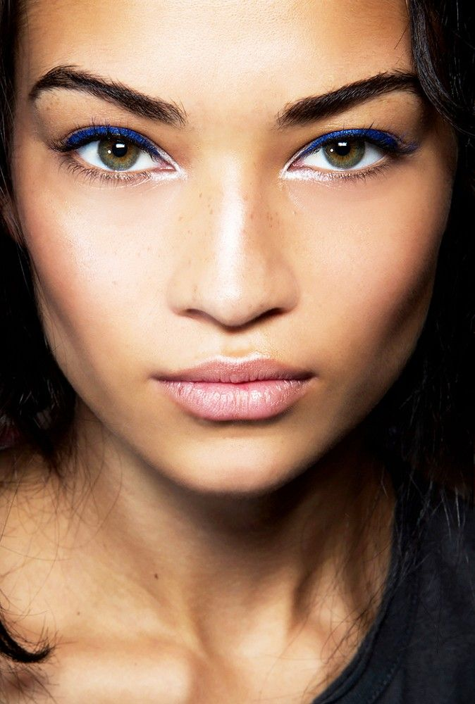 Add a touch of blue eyeliner to frosty lids and a pale pink lip