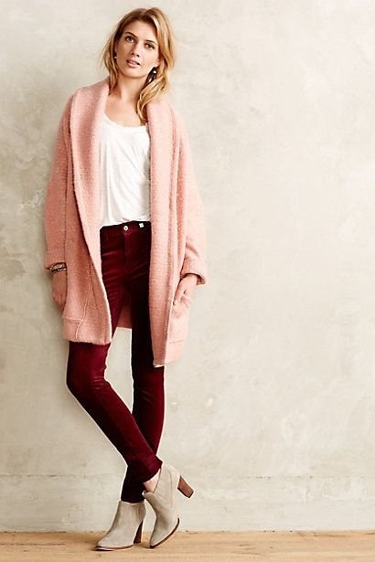 Try teaming a dusty pink knit cardigan with dark red corduroy skinny jeans for both chic and easy-to-wear look. For the maximum chicness rock a pair of grey suede ankle boots.  Shop this look for $64:  http://lookastic.com/women/looks/ankle-boots-skinny-jeans-bracelet-cardigan-tank/4887  — Grey Suede Ankle Boots  — Burgundy Corduroy Skinny Jeans  — Gold Statement Bracelet  — Pink Knit Cardigan  — White Tank