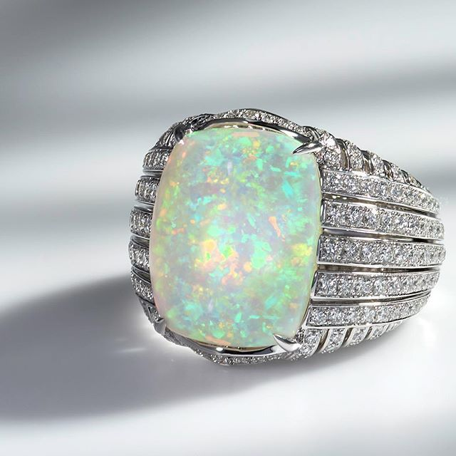 Kat Florence Welo Opal Ring with diamonds and a vibrant play of color!