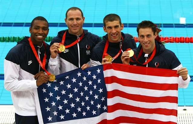 Best relay ever, Cullen Jones, Jason Lezak, Michael Phelps, Garrett Weber-Gale of the United States pose with the gold medal during the medal ceremony for the Men's 4 x 100m Freestyle Relay.