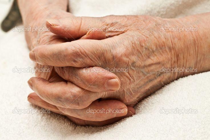 Old hands clasped on knees — Stock Photo © vesnanonstop #1304053