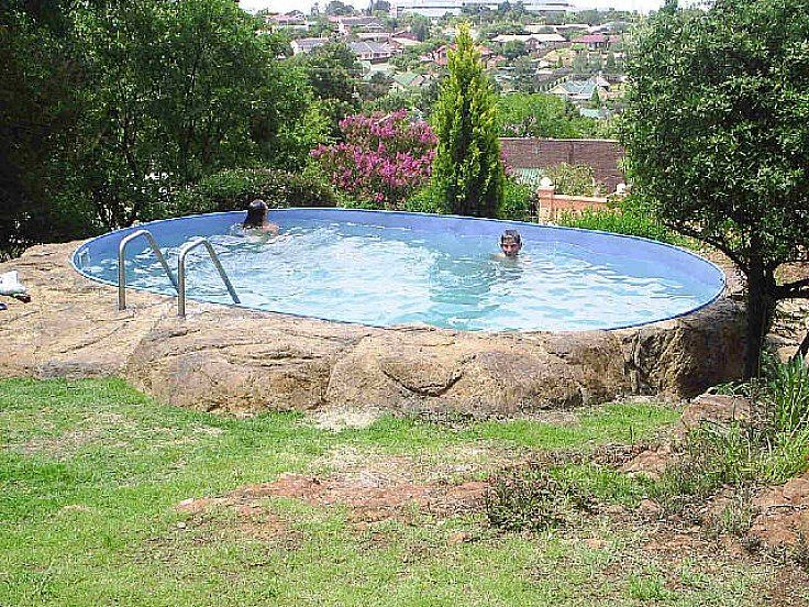Stone above ground swimming pool ideas pictures pools for Above ground pool decks oklahoma city