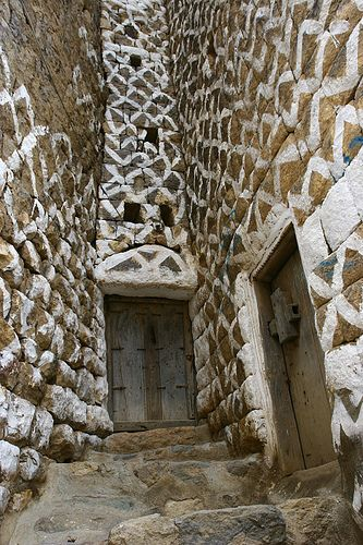 Decorative patterns on old stone wall - Yemen