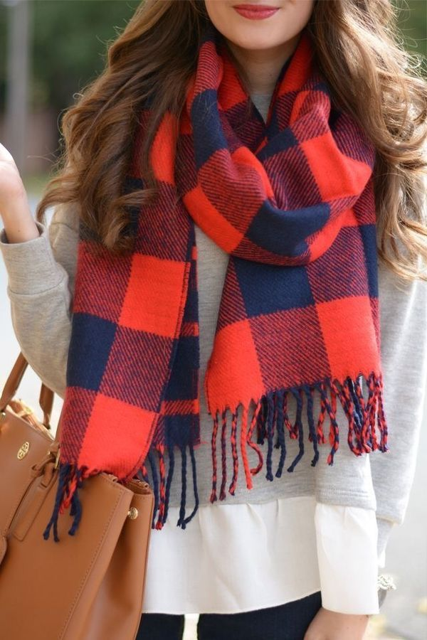 A bold plaid in a chunky winter scarf adds a vibrant colour pop to a neutral outfit. Try monochrome tops and bottoms to avoid adding volume to the figure with the scarf. Photo credit- Angel Style