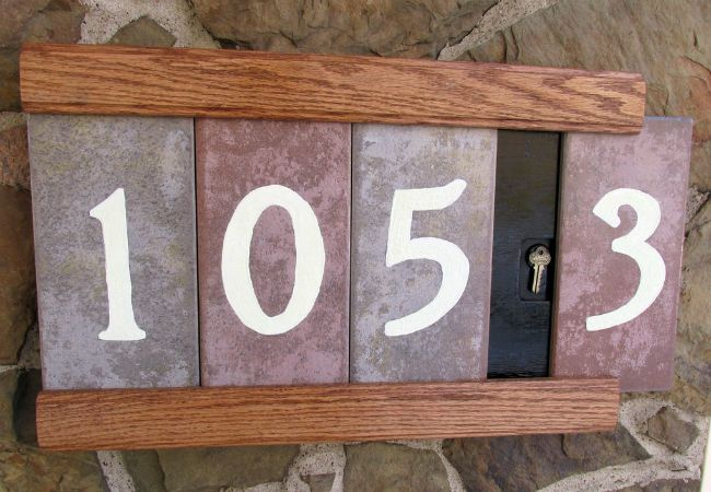 Use leftover tile as curb appeal - paint on house numbers for style you can spot from the street