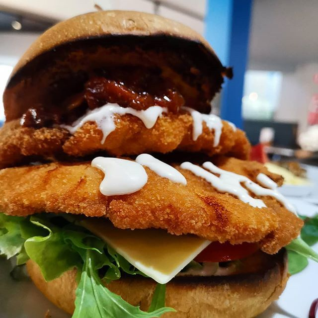 Chicken Schnitzel Burger Wow This Monster Is Bound To Sell Out Fast So Come In And Grab Her Chicken Schnitzel Burger Chicken Schnitzel Burger Cafe Food