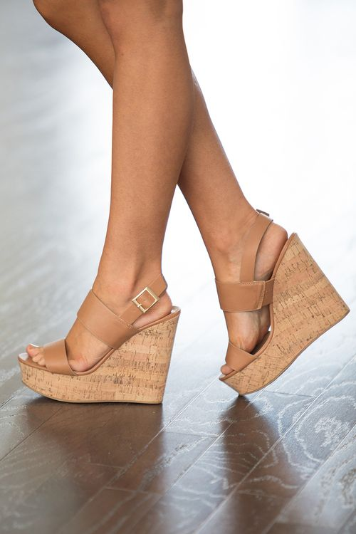 These sweet wedges are the perfect accessory for spring afternoons and summer nights! Featuring a classic camel color, large straps in the front, and an open toe, it's such a stylish and versatile loo
