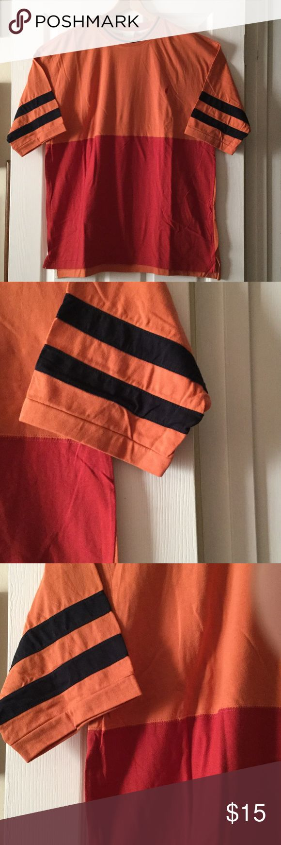 Short sleeve multi color t shirt Men's shirt sleeve crew neck t shirt, front of shirt is red and orange with navy blue bands on the sleeves, back is solid orange, hi low hem with side slits, new with no tags from a smoke free home jockey Shirts Tees - Short Sleeve