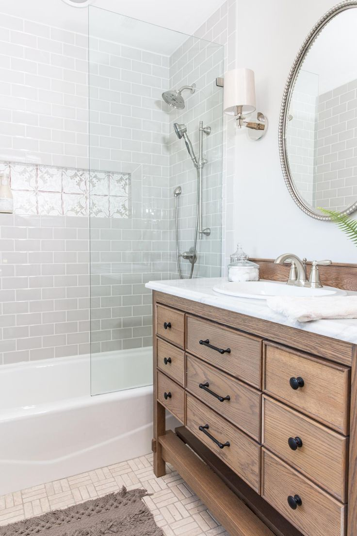 Even though we enlarged the master bath, it still isn't huge. We maximized it by having our cabinet maker, Marvin, build a beautiful custom vanity that didn't take up precious space. It has a classic design, and its size helped the bathroom feel roomy without skimping on storage space. #cabinetmakers