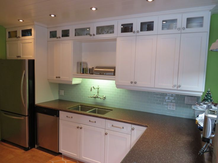 Kitchen-white cabinets. A tile back splash is a great way to bring in a pop of color. www.thisnthatmfg.ca