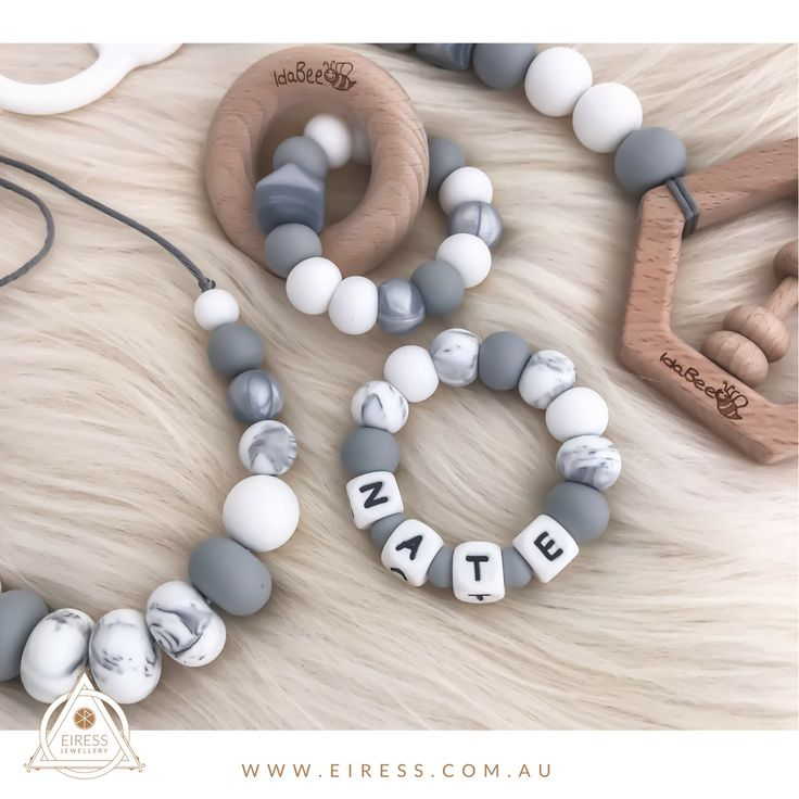 A gorgeous neutral grey set including the EASE personalised teething ring, Ellipse Amia Argent teething ring, playgym/pram toy Heksagon and Kove Grey Marble necklace for mum.