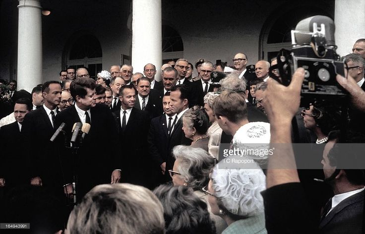 WASHINGTON, DC - OCTOBER 10: President John F. Kennedy awards the Collier Trophy to the seven Mercury astronauts in the White House rose garden.