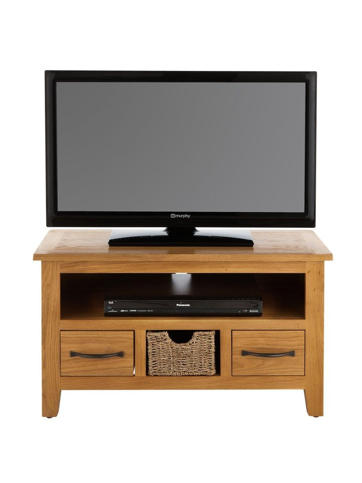 London Seagrass Ready Assembled 2 Drawer Small Oak TV Unit with Pull-Out Basket – suitable for televisions up to 34 inch Crafted from a combination of solid oak and oak veneers, this TV unit from the London Seagrass collection will arrive at your home ready assembled. This means you'll immediately notice how its breathtaking grain and warming colour tone complement your television. Two drawers are accented with curved metal handles, and a single pull-out seagrass basket adds a touch more…