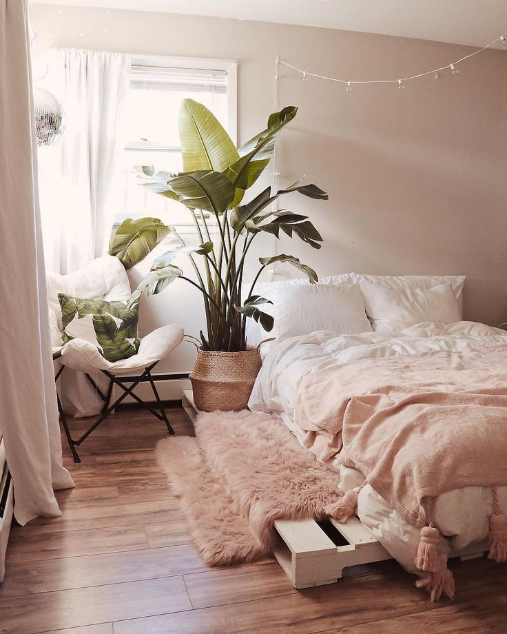 Tremendous cozy Scandinavian bed room with mushy textiles in pink hue, flooring plant and …