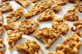 PEANUT BRITTLE  Simple, classic recipe for Peanut Brittle!     INGREDIENTS:       	2 cups granulated white sugar   	1 cup water   	1 cup light corn syrup   	2 cups raw or roasted & salted peanuts   	1/4 teaspoon salt (if you used raw