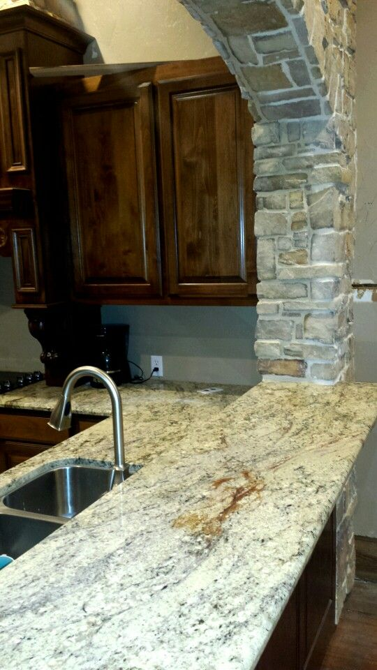 This Is Your Granite With The Dark Cabs.and A Stone Or Brick Wrap Arch.  Just Pulling For Color Combo And Reference.