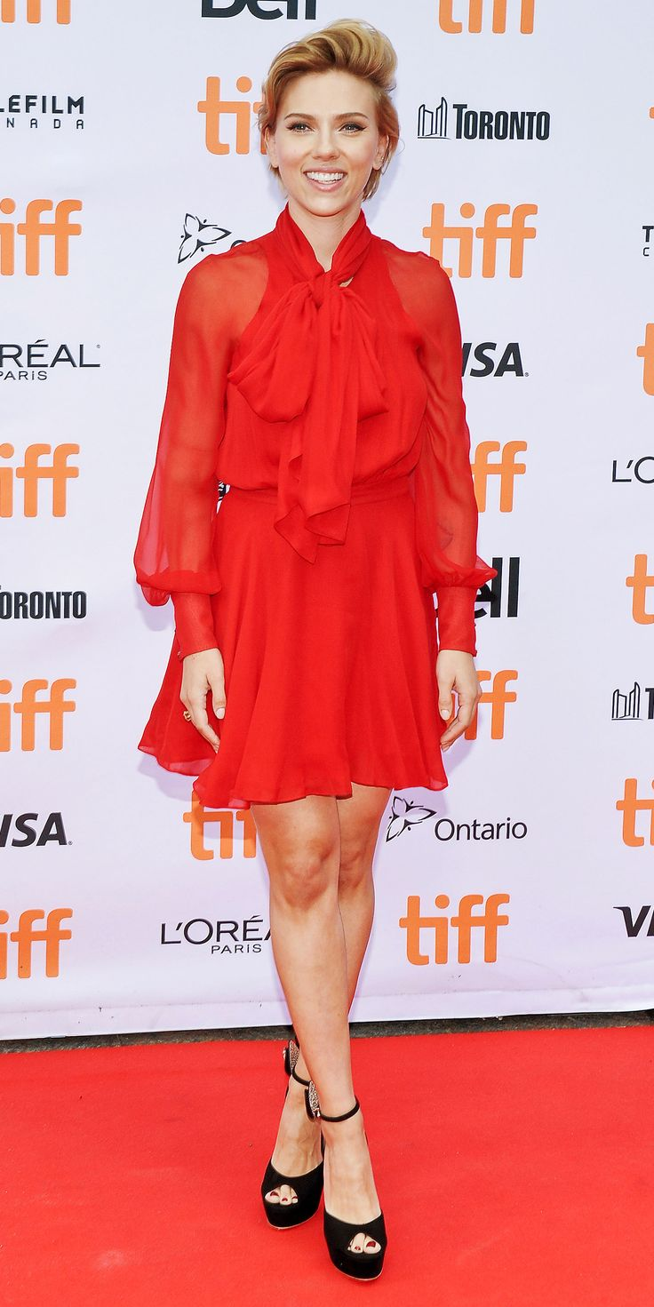 Scarlett Johansson sizzled at the premiere of Sing during TIFF in a stunning crimson tie-neck, sheer-sleeved Haney dress, complete with black Sophia Webster platforms embellished with crystal-studded bows from the back.