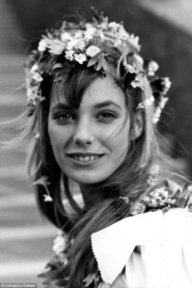 Jane Birkin pictured in the film Wonderwall, where she played model Penny Lane, wearing a flower crown in the wedding scene from the film