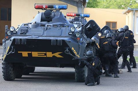 An assault unit of TEK prepare a raid. TEK - Terrorelhárítási Közpon (translate is Counter Terrorism Centre) - is the SWAT state agency of Hungary, specialized for counter-terrorism, hostage crisis, gun violence, capturing dangerous criminals and protecting the Hungarian government and Hungarian citizens worldwide.