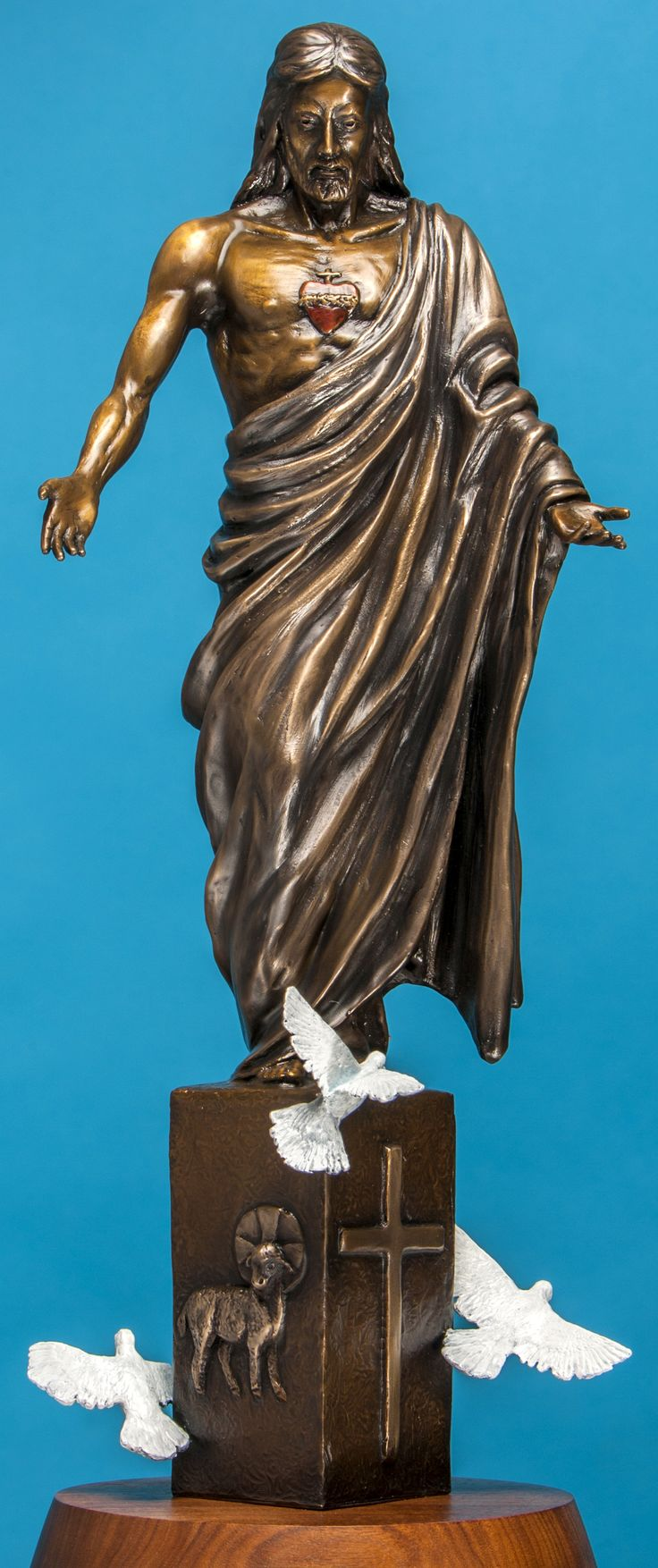 """''SACRED HEART OF JESUS'' - The twice life-size bronze monumental sculpture Height 17 feet Length 8 feet Width 7 feet. This bronze is also available in a table top size H-19'' L- 7'' W-7'' price 1600. call 307-259-7305  The Sacred Heart will have light radiating out from within for it is a sign of the love Jesus has for us. """"Jesus has loved us all with a human heart''. In my sculpture ''The Sacred Heart of Jesus'' I show Jesus with open arms, for it is the inviting expression of peace. In…"""