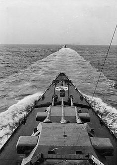 Foredeck of 11 in German battleship Scharnhorst as she follows a minesweeper in the early war years, occasion uncertain but probably taken during the 1940 operations off Norway: in June she was torpedoed and damaged by one of carrier HMS Glorious's two escorting destroyers as she sank all three British ships whilst acting together with sister Gneisenau.