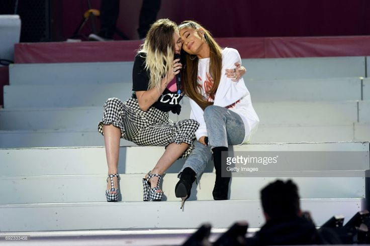 NO SALES, free for editorial use. In this handout provided by 'One Love Manchester' benefit concert (L) Miley Cyrus and Ariana Grande perform on stage on June 4, 2017 in Manchester, England. Donate at www.redcross.org.uk/love