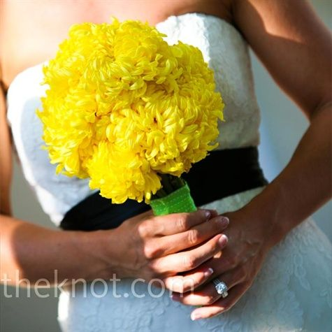 I like these for my bridesmaids!  Andrea picked up bright-yellow chrysanthemums at the Los Angeles Flower District and wrapped them tightly together with green ribbon.