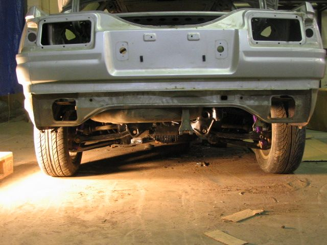 There are at least two Japanese manufacturers who have decided to correct this problem by offering Nissan s14 rear end suspensions for the ae86. This isn't a weld in proposition. It's literally a bolt-in space frame that locates the s14 independent dif under the car. Think about it for a second…this means you get an OEM limited slip, retain the factory suspension mounts and requirements, and gain rear independence and big disk brakes!  _ irs.jpg (640×480)
