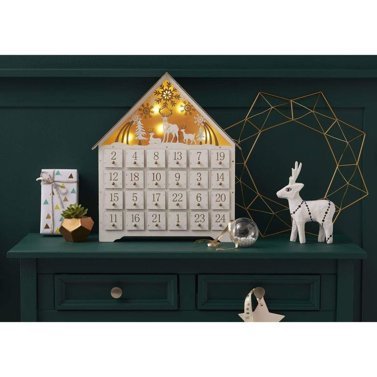 Led Wooden House Advent Calendar | Hobbycraft | Count down the sleeps until Christmas with this charming advent design! Decorate with paint, glue, glitter, decoupage and more to make each day something special. Pop in a series of seasonal treats or crafty delights for your loved ones to enjoy. This wooden house will light up with bright LEDs to add a little extra shine to your seasonal celebrations.