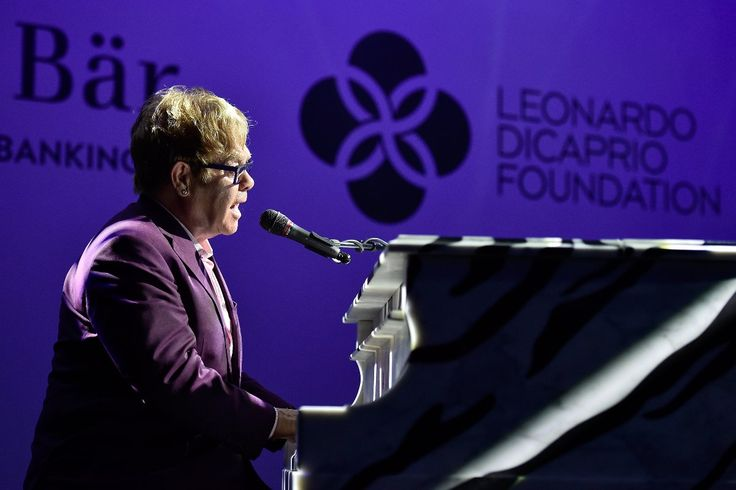 SAINT-TROPEZ, FRANCE - JULY 22:  Elton John performs on stage Dinner and Auction during The Leonardo DiCaprio Foundation 2nd Annual Saint-Tropez Gala at Domaine Bertaud Belieu on July 22, 2015 in Saint-Tropez, France.  (Photo by Handout/Getty Images)
