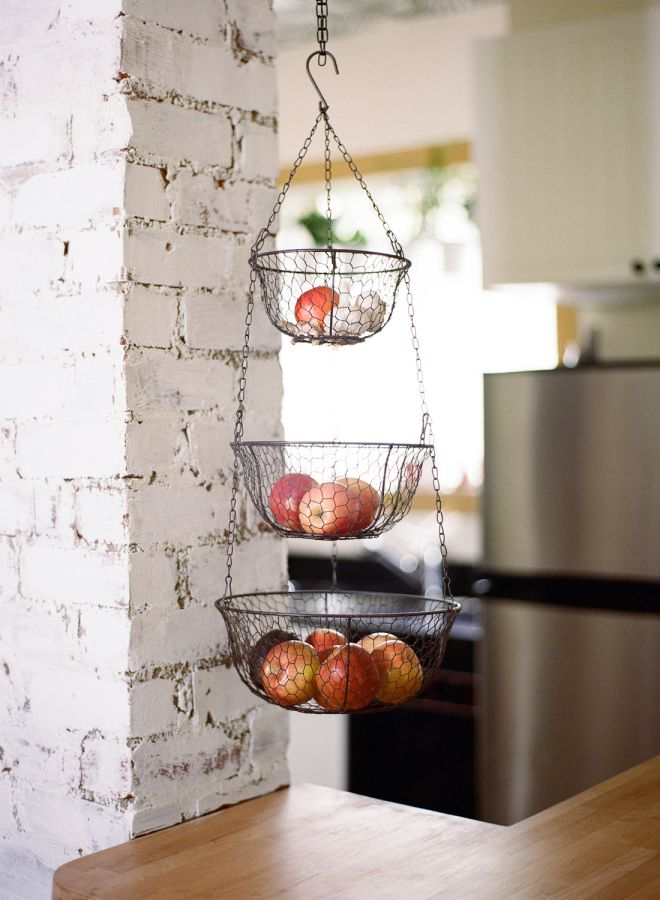Hanging fruit basket: http://www.stylemepretty.com/living/2016/05/05/condo-living-can-be-luxurious-and-heres-the-proof/ | Photography: Audra Wrisley- http://audrawrisley.com/
