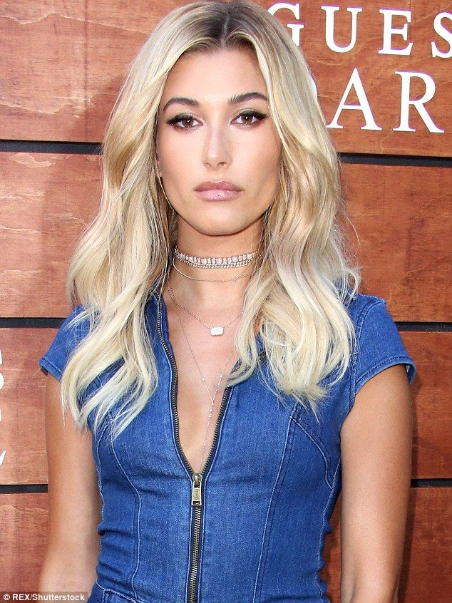 Elegant beauty: Hailey highlighted her more subtle allure with delicate diamond necklaces...