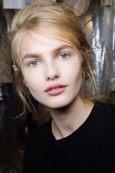 A natural beauty look, backstage at the John Galliano runway show at Paris Fashion Week Spring 2016.
