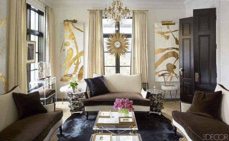 In the living room of the Lake Forest, Illinois, home that designer Megan Winters shares with her husband, Patrick, the Lucite console, gilt chairs flanking the window, and settees, which are covered in Schumacher fabrics, are all by Megan Winters Collection; the artworks are by Allison Cosmos, and the French sunburst clock is a Paris flea-market find.