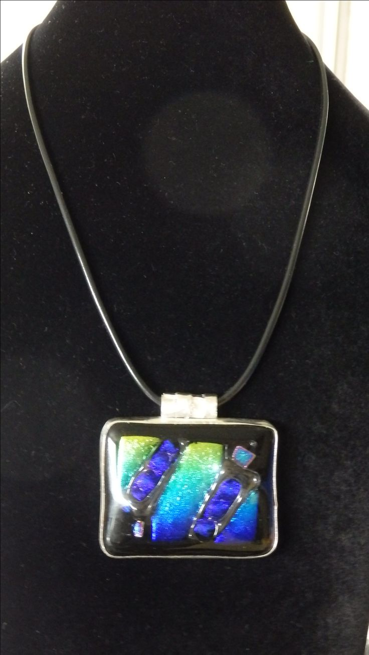 DICHROIC GLASS & sterling silver bezel, with freeform plaited sterling bail.  Very heavy and eye-catching - especially in the sun!