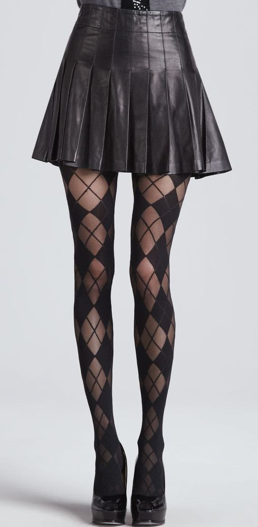 Skirt complete with leather, pleats, and short length? With tights that are black, sheer, and patterned with argyle? Yes please!